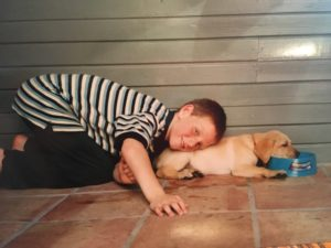 Sam at age 7 with his first dog, Ozzie